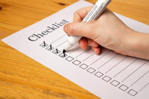 A blank moving checklist being checked off