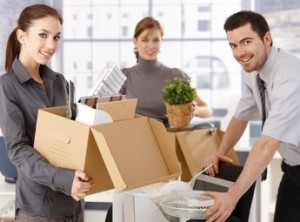 Office employees packing for a move