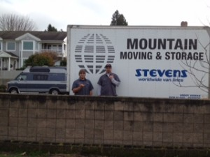 Mountain Moving crew in front of truck