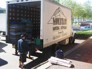 Crew unloading moving supplies