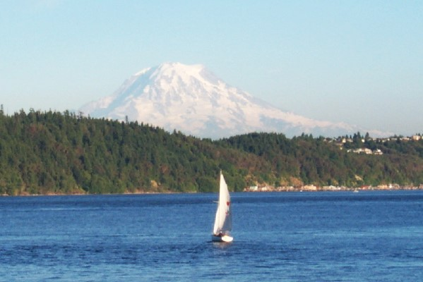 Sail boat in Gig Harbor with Mount Rainier in background
