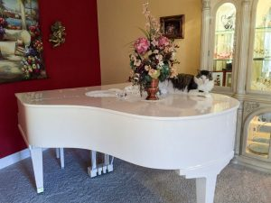 antique white piano